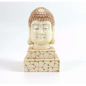 Escultura representando de cabeça de Budha em marfim. China Sec XX. - 22 cm alt.