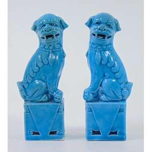 Par de Esculturas de cerâmica esmaltada monocrômica em azul representando Cão de Fó .lt.China Sec XXC 13 cm alt.