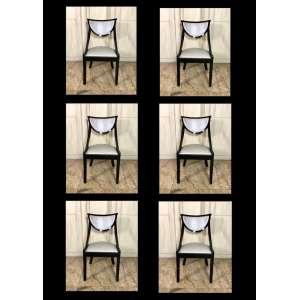 Jogo composto por seis cadeiras de madeira ebanizada e estofadas.