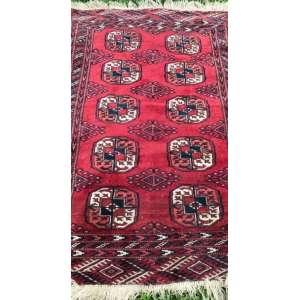 Tapete russo, Buhara, manufatura manual, 1,35m x 90cm (no estado).
