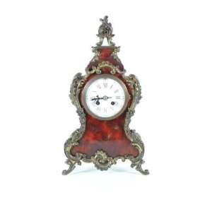 Relógio de mesa de madeira e tartaruga, ornamentado por bronze, elegante mostrador em esmalte, relojoeiro L.R Brevete, 41cm x 18cm, Europa, século XIX.