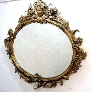 Grande espelho Oval de madeira lavrada e dourada . Europa Sec XIX- 155 x 155 cm. (no estado)