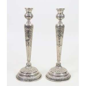 Par de castiçais em prata de lei teor 833. Brasil Sec XX. - 30 cm alt.