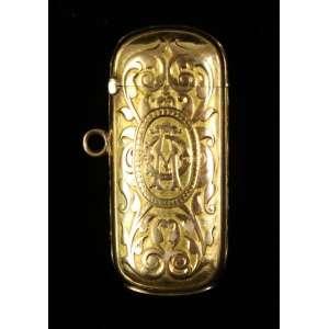 Fosforeira em ouro finamente trabalhado 18 k - 5 x 2 x 1,0 cm , não contrastada, monogramada. Europa Sec XIX.