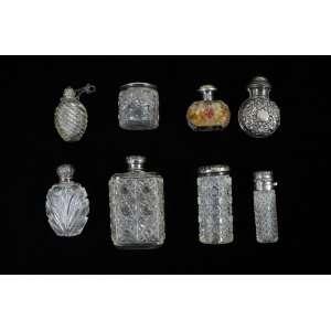 Coleção de 8 perfumeiros em cristal e prat de lei. Europa Sec XIX..