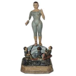 Nossa Senhora da Caridade do Cobre. Imagem de vestir, braços articulados apoiado em base simulando mar com barco e três figuras; 46 cm de altura. Cuba, séc. XIX.