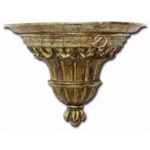 Peanha de madeira entalhada, policromia marmorizada com resquícios de douração; no reverso duas alças de metal; 36 x 18 x 27,5 cm de altura. Brasil, séc. XIX.