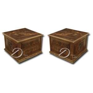 Par de móveis auxiliares de madeira com duas gavetas, decorado com três rosetas entalhadas e puxadores de metal, saia; 80 x 80 x 56 cm de altura. Brasil, séc. XX.