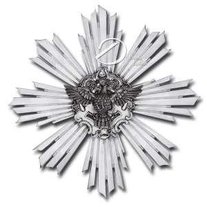 Divino Espírito Santo. - Imagem de prata repuxada e cinzelada representando uma pomba sobre placa trabalhada decorado com volutas e resplendor raiado; 40 cm de diâmetro. Brasil, séc. XVIII.