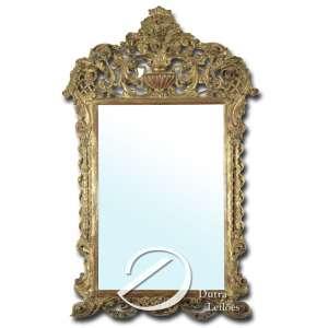 Espelho com moldura, estilo barroco, com resquícios de douração; 145 x 92 cm. Brasil, séc. XX.