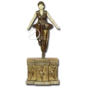 D. H. Chiparus. Oriental Dancer. Escultura de bronze patinado e marfim representando dançarina apoiada em um só pé, cabeça e braços de marfim, base de ônix marrom com placa frontal recortada de bronze decorada com dançarinas, assinada no topo da base Chiparus, numeração 35 estampada na perna, placa com dedicatória Pour A. Goudet na face anterior da base; 40 cm de altura. França, séc. XX, c. 1925. Escultura semelhante reproduzida a página 93 do livro Chiparus - Master of Art Deco por Alberto Schayo.