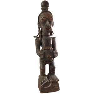 Arte étnica africana. Maternidade, escultura de madeira, da cultura Songye - Lubá. Ex-Congo; 82 cm de altura.