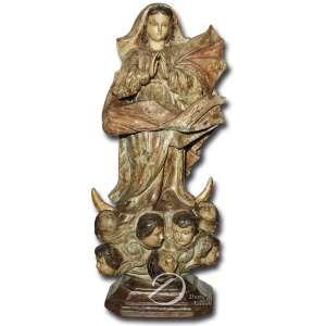 Nossa Senhora da Conceição. Imagem de madeira esculpida, policromada, bom panejamento, mãos espalmadas e olhos de vidro; na base sete anjos com asas, sobre pedestal e base quadrada recortada; 76 cm de altura. Brasil, séc. XVIII.
