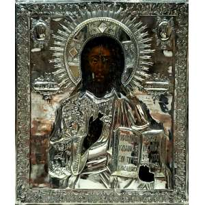 ÍCONE pintada a óleo guarnecida por metal espessurado a prata ricamente decorado - 31,5 x 27,5 cm - Rússia, séc. XIX