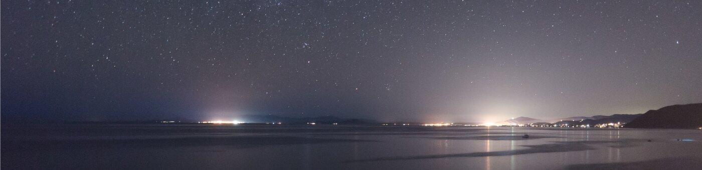 Noche estrellada en la playa