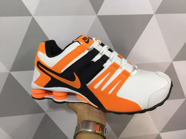 new product 590b0 9af60 Tênis Nike Shox Current - Branco Laranja ...