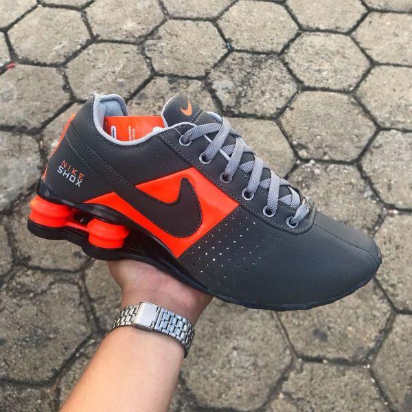 ce525d6a34a Tênis Nike Shox Deliver Cinza c  Laranja - Outlet Ser Chic