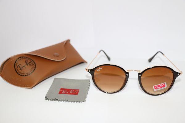 5aac6300d Óculos Round Rb2447 - Loja de Elnshop