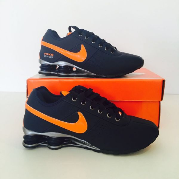 583642d3ddd Tênis Nike Shox Deliver Azul C  Logo Laranja
