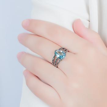 Anel Folheado Ródio Negro com Cristal Gota Azul Claro e Micro Zircônia Cristal