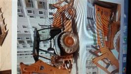 Retroescavadeira 580N 4x4 ano 2012