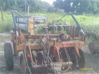 Grade aradora 16 discos 26 com pneus e pistão