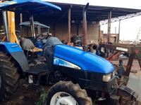 Trator Ford/New Holland TL60 4x4 ano 06