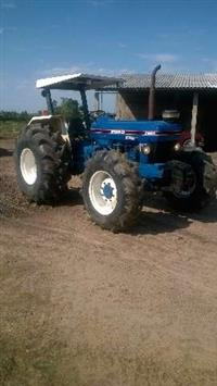 Trator Ford/New Holland 7610 4x4 ano 92