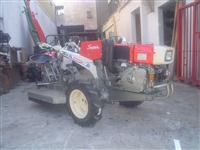 Mini/Micro Trator TC11SUPER PARTIDA ELETRICA  COM APARADOR DE GRAMA  4x2 ano