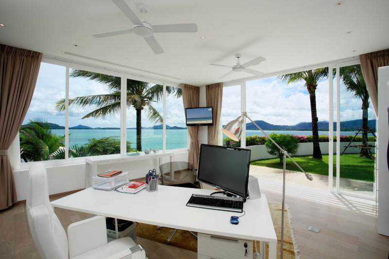 Marvelous-Home-Office-Design-Applied-White-Table-and-White-Swivel-Chairs-in-Oceanfront-Villa-Offering-Beautiful-Outside-View