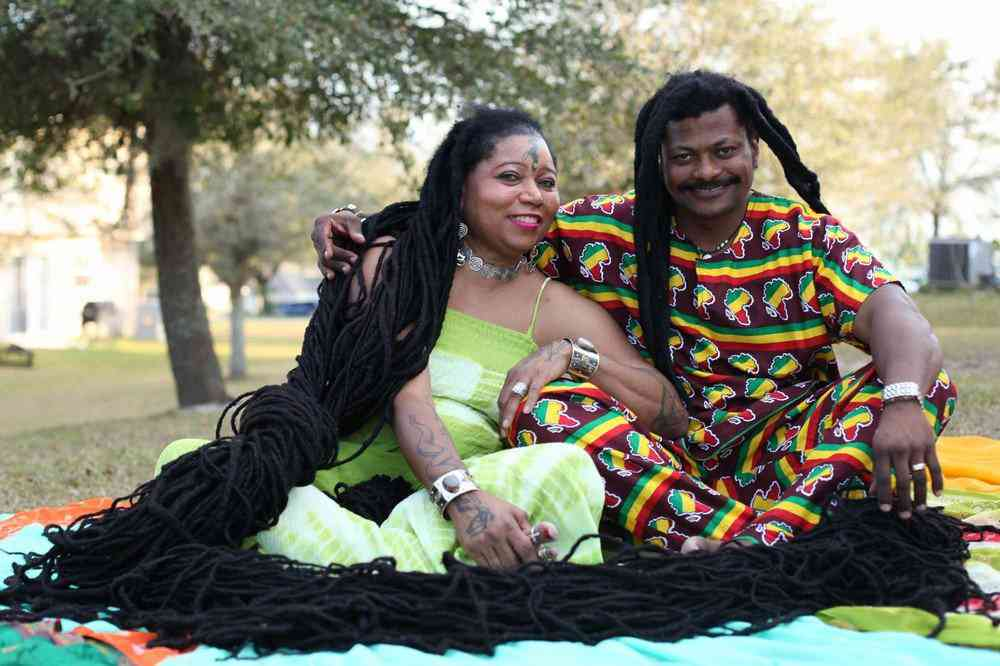 *** EXCLUSIVE - VIDEO AVAILABLE *** ORLANDO, FL - MARCH 1: Asha Mandela with her husband Emmanuel Chege at home on March 1, 2016 in Orlando, Florida. The woman with the world?s longest hair has found love with a hair stylist whose massive dreadlocks rival her own. Real life ?Rasta-Rapunzel,? Asha Mandela, has dreadlocks that measure 55ft - longer than a London bus. Now the 50-year-old, from Florida, has married her dream man, Emmanuel Chege, a qualified hair stylist from Kenya. PHOTOGRAPH BY Ruaridh Connellan / Barcroft USA UK Office, London. T +44 845 370 2233 W www.barcroftmedia.com USA Office, New York City. T +1 212 796 2458 W www.barcroftusa.com Indian Office, Delhi. T +91 11 4053 2429 W www.barcroftindia.com