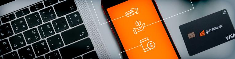 Imagem de um celular sobre a mesa, mostrando, numa tela laranja, três ícones que representam conta corrente, conta de pagamento e conta digital.