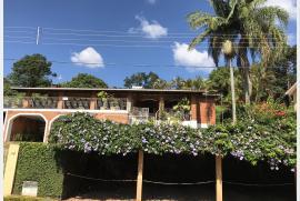 Chacara à venda Dos Silva, SP - 1320999989-condominio-a-montanha-ou-40-casas-morungaba-casa-14-fachada.JPG