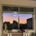 Eliza, que procura negociar um imóvel em Auxiliadora, Mont' Serrat, Moinhos de Vento, Porto Alegre, em torno de R$ 2.000