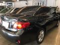 120_90_toyota-corolla-sedan-xei-1-8-16v-flex-aut-08-09-343-9