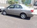 120_90_toyota-corolla-sedan-xei-1-8-16v-02-03-15-7